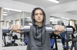 The teenager is engaged in power fitness Royalty Free Stock Images