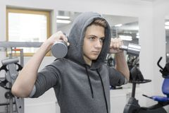 The teenager is engaged in power fitness Stock Images