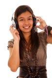 Teenager enjoying good music Stock Images