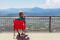 Teenager enjoying mountainous landscape Royalty Free Stock Photo