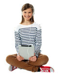 Teenager enjoying music through headphones Stock Images