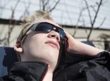 Teenager enjoying springs first sunbeams stock photography