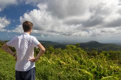 Teenager enjoying a view of tropical landscape in Guadeloupe, Caribbean. Stock Photos