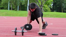 Teenager exercising with dumbbells stock footage