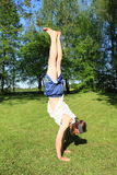 Teenager exercising handstand Stock Images