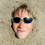 Teenager Face in the Sand Royalty Free Stock Photography
