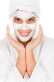 Teenager facial mask - happy woman Stock Image
