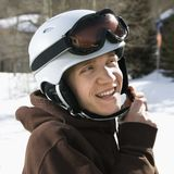 Teenager fastening helmet. Stock Photo