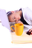 Teenager Fell Asleep While Working on the Computer. Teenager Drinking Coffee While Working on the Computer Fell Asleep Royalty Free Stock Photography