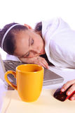 Teenager Fell Asleep While Working on the Computer. Teenager Drinking Coffee While Working on the Computer Fell Asleep Stock Photos