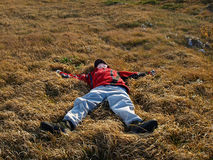 Teenager fell into the thick grass Stock Image