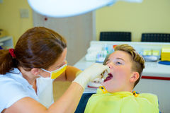 Teenager at a female dentist`s surgery Royalty Free Stock Photo