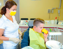 Teenager at a female dentist`s surgery Royalty Free Stock Photos