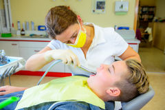 Teenager at a female dentist`s surgery Royalty Free Stock Images
