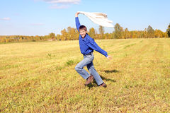 Teenager in a field Stock Photo