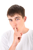 Teenager with Finger on his Lips Stock Photo