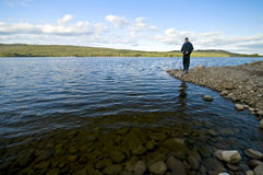 Teenager fishing royalty free stock images