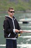 Teenager fishing royalty free stock photos