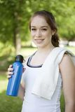 Teenager and fitness. Teenager outside with water bottle and towel after exercising Stock Images