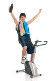 Teenager fitness bike Stock Photography