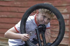 Teenager fixing bicycle Stock Photo