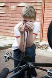 Teenager Fixing Bicycle Chain Royalty Free Stock Photos