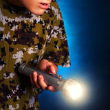 Teenager with Flashlight Royalty Free Stock Image
