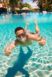 Teenager floats in pool Royalty Free Stock Photos