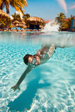 Teenager floats in pool Royalty Free Stock Images