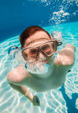 Teenager floats in pool Stock Photo