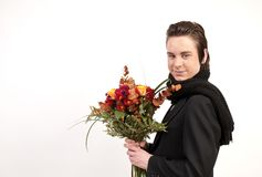 Teenager with flowers Stock Images