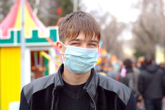 Teenager in flu mask. Teenager in the flu mask outdoor Stock Photography