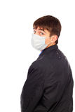 Teenager in flu mask Stock Photography