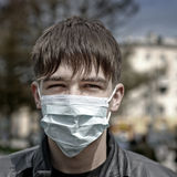 Teenager in Flu Mask Stock Photo
