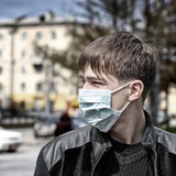 Teenager in Flu Mask Stock Image