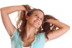 Teenager fluffing hair Royalty Free Stock Photo