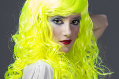 Teenager with fluorescent yellow wig Royalty Free Stock Image