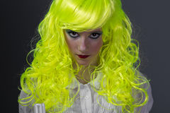 Teenager with fluorescent yellow wig Stock Photography