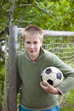 Teenager with football ball Royalty Free Stock Images