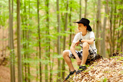 Teenager in the forest Royalty Free Stock Photos