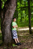 Teenager in the forest Stock Image