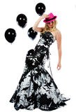 Teenager in a formal dress and pink hat Royalty Free Stock Photo
