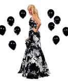 Teenager in a formal dress surounded by baloons Royalty Free Stock Photography
