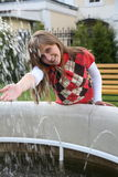The teenager at a fountain Royalty Free Stock Images