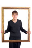 Teenager with frame Royalty Free Stock Image