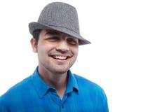 Teenager freddo con un cappello - isolato Fotografia Stock