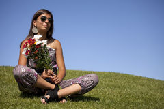 Teenager with fresh flowers Royalty Free Stock Photography
