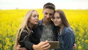 Teenager friends posing and taking selfies stock video footage