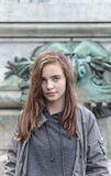 Teenager in front of an ancient ornament Royalty Free Stock Photography