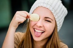 Teenager - fun with chips Stock Images